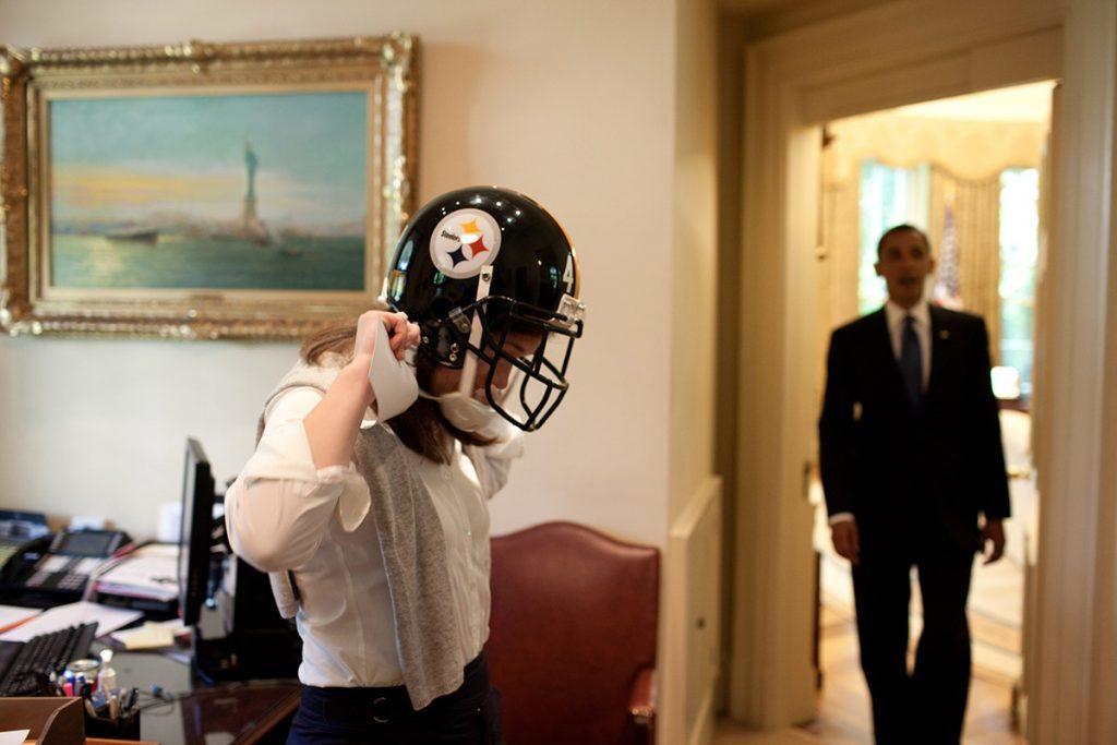 Obama watches Katie Johnson try helmet