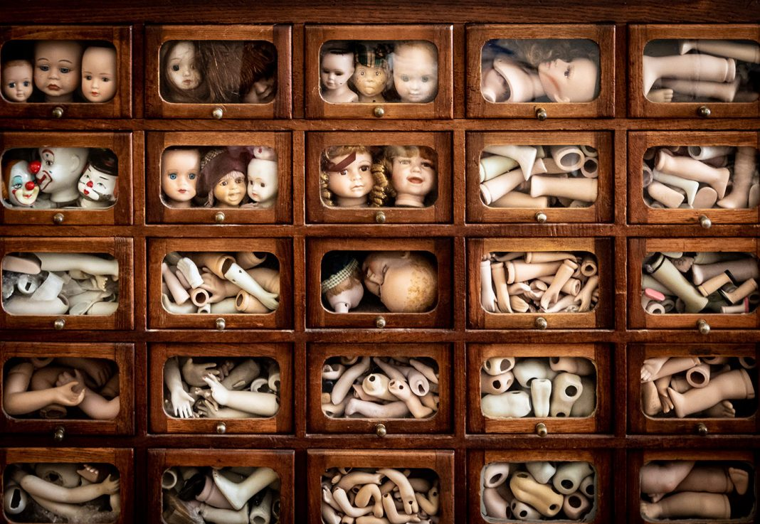 Cabinet of doll parts